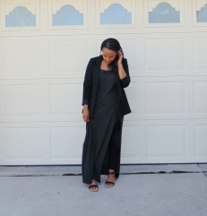 black blazer dark gray maxi dress with high slit black leggings black strappy heels