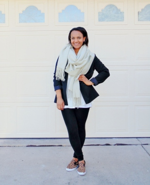 nude oversized scarf over white button up black blazer and black leggings leopard sneakers